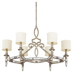 Metal chandelier with a silver and gold leaf finish and cylindrical fabric shades.   Product: ChandelierConstruction ...