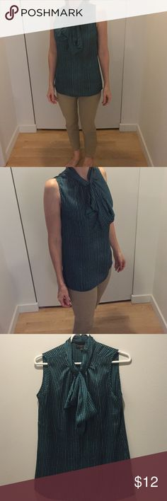 Green sleeveless blouse This emerald green sleeveless blouse is 100% polyester. Looks good tucked in or not. The Limited Tops Blouses