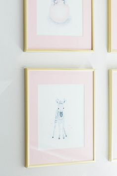 gold frames and pink mat gallery wall art in this blushing nursery Photography : Lindsey Kay Photography Read More on SMP: http://www.stylemepretty.com/living/2016/08/22/having-a-baby-girl-this-blush-gold-nursery-is-a-must-see/