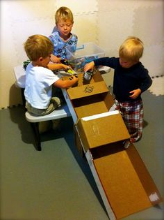 Here you go babe race car ramp! Get on it! @Jason Hershberger diaper box = race car track with tunnel.