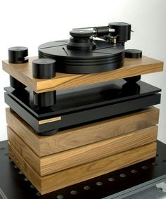 MInimalist design, but the wood (old school) matches well with the media (also old school).  Stunning!