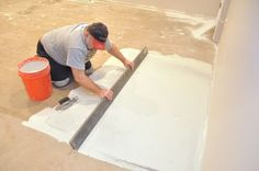 Describes how to level a concrete slab, plywood, or OSB subfloor using latex-modified mortar. Demonstrates a variety of techniques to detect uneven areas.