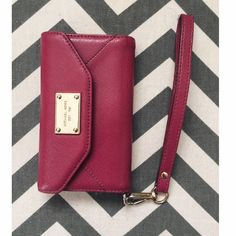 Michael Kors IPhone 5/5s wallet Michael Kors iphone 5/5s phone case and wallet wristlet! Has some wear and tear but still in decent condition. I love the color and simplistic look.  Michael Kors Accessories Phone Cases