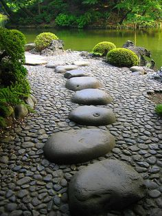 We don't know about you, but these stepping stones in Japanese #Garden look like they could be pretty dangerous when wet! #gardening #landscape