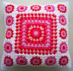 crochet granny square cushion cover / pillow cover in red and pink in white edging by handmadebyria on Etsy https://www.etsy.com/listing/264476596/crochet-granny-square-cushion-cover