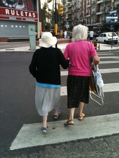 Caring for each other no matter what age.  Not sure if they are mother/daughter, sisters or friends.  Off too the beach they go with folding chair in hand