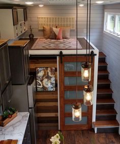 Blue Heron by Blue Sky Tiny Homes - Tiny Living There are two lofts, one with storage stair access and the other with an attic style ladder. Each loft has built-in shelving and a headboard. Tiny House Loft, Best Tiny House, Tiny House Living, Tiny House Plans, Tiny House Design, Tiny Loft, Tiny House Office, Tiny House Bedroom, Plans Loft