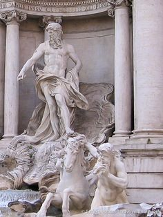 Trevi Fountain . statue of Oceanus and one of the Tritans