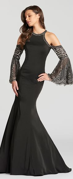 Long sleeve stretch crepe and embroidered trumpet dress with jewel neckline, shoulder cut outs, and embroidered illusion back panels with a keyhole.