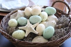 A beach style easter basket display. http://www.seasideinspired.com/seashells.htm