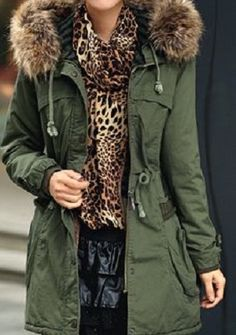 love the olive green coat with fur trim!