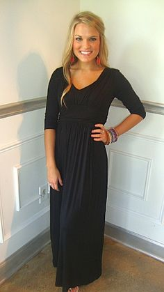 Angie 3/4 Sleeve Maxi     It's BACK!!! Get all the look without the price in this designer knock-off! This knit maxi is sure to be an absolute staple in your wardrobe. The ¾ sleeves will easily take you into the autumn months and the basic black color will match everything in your closet!