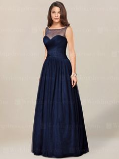 Simple mother of the bride dress is made in Tulle. Sheer bateau neckline over sweetheart bodice is trimmed with beaded accents. Crisscross ruching shapes the figure till drop waist. Shirred floor length skirt finishes the dress. Available in 60 colors, show in Navy.