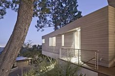 An Astonishing Contemporary Homestead Below The Hollywood Sign : Modern Residence Outdoor With Steel Fence And Wooden Wall Panel And Ceiling Lamp