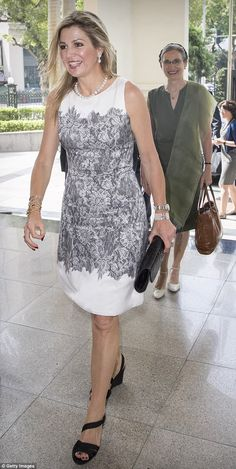 If she was feeling the heat in Vietnam, there was no sign of it on Queen Maxima's face as she arrived in Hanoi to meet with the country's finance minister Dinh Tien Dung on Thursday.