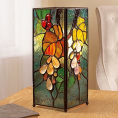 Grapevine Stained Glass Lamp Smart stained glass lamp featuring a raised grapevine design inspired by the leaded glass lamps created by Louis Comfort Tiffany from Glass Painting Designs, Stained Glass Designs, Stained Glass Projects, Stained Glass Patterns, Stained Glass Lamp Shades, Stained Glass Light, Leaded Glass, Mosaic Glass, Fused Glass