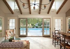 Pool house - open beam ceiling, stone flooring, large set of patio doors.