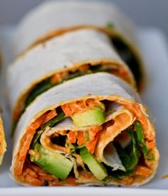 Easy to make, #energy packed, and #veggie friendly! #Hummus wraps with carrot, avocado, edamame & spinach.