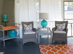 Make your screen porch an outdoor room. You can extend the size of your home by creating an outdoor space that feels like part of your home. Adding curtains gives the space a feeling of privacy like being indoors. Add a bar cart for outdoor entertaining. This can become a multifunctional space to enjoy during the warm weather! Sponsored by Homegoods, Homegoods Happy by Design. (Pillows, chairs, side table, lamp, bar cart, accessories all found at Homegoods)
