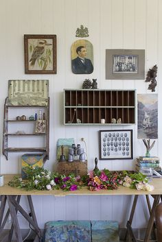 the naturalist desk covered with roses from the garden of the old schoolmasters house www.oldschoolmasterhouse.com.au