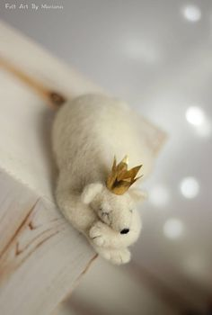 This little needle felted Bear was born in Sofia a few days ago. He has snow white fur, black nose and crown, while waiting for his princess hes sleeping on the iceberg. I use felt needle techniques and 100% pure wool form Bulgaria. He has special handmade brass crown Size in
