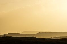 Golden Mountain Landscape - Mountain landscape bathing in golden late afternoon light in southern Iceland