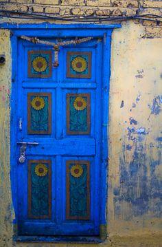 blue door with sunflowers