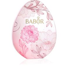 """Celebrate the arrival of spring with the BABOR Easter Egg. This year, the popular egg is adorned with delicate floral blossoms and a hint of pink. Hidden behind each of the 14 """"windows"""" on the outside of the egg is a selected BABOR Fluid – 2 ml of highly concentrated active ingredients sealed in a glass ampoule. This two-week intensive treatment is specially designed to instantly give your skin a much-needed boost of freshness and ensures a flawless complexion."""