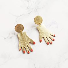 Frosty Mint: Handmade Gold and Red Leather Hand Earrings by Benu Made