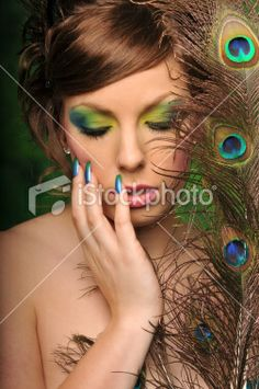 Google Image Result for http://2.bp.blogspot.com/_At7vQHJ1I6Y/TL-dHVD25lI/AAAAAAAAAIc/HysaNt7rnCE/s1600/ist2_11709540-beautiful-young-woman-with-artistic-makeup-and-peacock-feathers.jpg