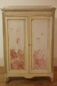 An antique country pine two door painted armoire, the painted…