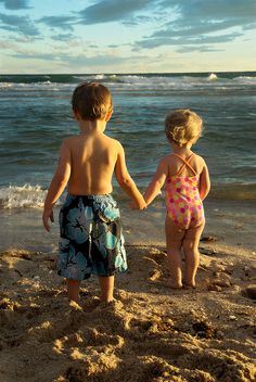 Kids at the beach. If you lead, I will follow.