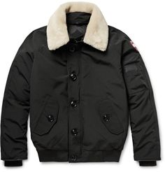 <a href='http://www.mrporter.com/mens/Designers/Canada_Goose'>Canada Goose</a>'s iconic cold-weather designs use modern technology and premium down to create supremely warm outerwear. The quilted interior of the 'Foxe' bomber jacket is filled with natural duck down and encased in the brand's signature Arctic Tech shell exterior. A neat leather-backed collar is trimmed with a detachable shearling overlay that can be removed as desired. The YKK® two-way zipper, large button fastenings and…