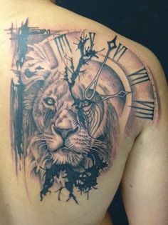 Lion on hourplate tattoo in back