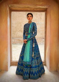 Make a grand entry at the wedding adorning this meticulously handcrafted lehenga ensemble by Vasansi Jaipur. Whatsapp us now for personal shopping experience! Call/WhatsApp for Purchase Inqury : Lehnga Dress, Bridal Lehenga Choli, Indian Lehenga, Blue Lehenga, Designer Bridal Lehenga, Ghagra Choli, Anarkali Lehenga, Pakistani Lehenga, Indian Wedding Lehenga