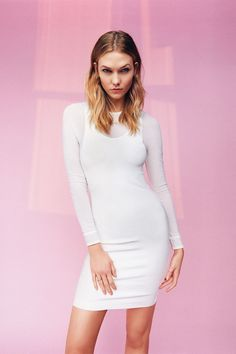 Karlie Kloss poses in a bodycon white dress for Topshop spring-summer 2016 campaign