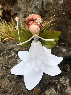 This item is a hanging ornament. She can also stand on her own on a flat surface. This item does not have legs like my other fairy dolls in order to allow for use as a topper for a small tree. Meet Angelina! She's a Snow Enchantress who blankets the mountains in snow. Her best friend