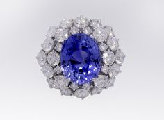 Natural Sapphire certified 13.28ct. and 7.10ct. of the finest Diamonds, 18kt. White Gold.