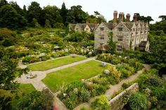 Gravetye Manor, an Elizabethan-era English country estate-cum-hotel and restaurant—once the home of prominent Irish-born gardener and writer William Robinson—surrounded by 30 acres of historic gardens. Photo courtesy of Gravetye Manor. English Country Gardens, English Countryside, Gravetye Manor, Brighton, Manor Garden, Garden Cottage, English Manor Houses, Country House Hotels, Country Hotel