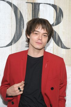 Charlie Heaton poses at a photocall during Christian Dior Couture...