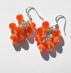 Cluster Dangle Earrings with Orange Cat's by creationsbycandice