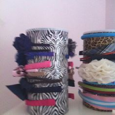 A home made hair accessory box. Use oat meal box and decorative duck tape on the outside of box. Accessories can be stored inside too :) Idea came from a co-worker's daughter.