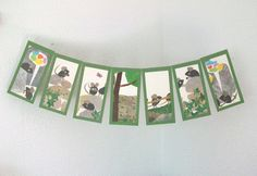 """Paper garland with scenes from """"Frederick"""" by Leo Lionni"""