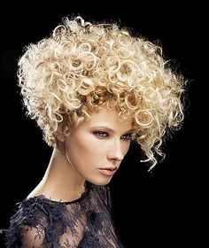 A Medium Blonde curly sculptured coloured volume womens hairstyle by Felicitas