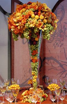 Fruit and floral arrangement by designer Preston Bailey - I have a book of his and his designs are fab!