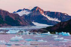 Photo of Scenic view of Bear Glacier Lake with icebergs at sunset, Kenai Fjords National Park, Kenai Peninsula and Mountains, Southcentral A...