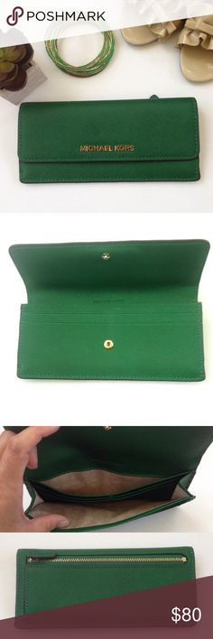"MICHAEL KORS Jet Set Travel Flat Wallet Gooseberry authentic MICHAEL Michael Kors Jet Set Travel Wallet in green Gooseberry colored saffiano leather with gold toned accents. Logo on front with snap closure. Back zippered pocket, inside 2 compartment currency and card slots in a tan fabric with the MK logo. EUC but has some very small wear on the ""s"" and the zipper. Approx meas 7.75""W, 3.5"" L, 1""D. No box or bag Michael Kors Bags Wallets"