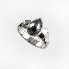 Black pear cut diamond with unique white gold band.