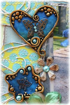 Such a Pretty Mess: Polymer Clay & Trinket Embellishment Tutorial (Bo Bunny DT) - love this, totally open as far as how you make them look, a great way to incorporate tiny items that are hard to stick down otherwise. @Bonnie Bullis