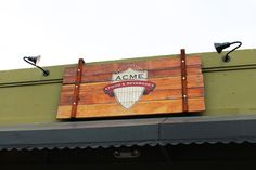 Hand Painted distressed barn wood sign with some copper leaf accents for our friends at Acme.